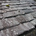 an old slate roof, chipped, weathered and worn